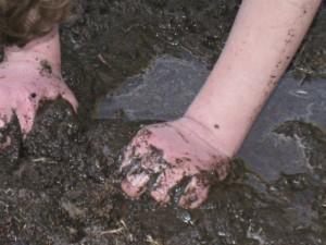 hands in mud